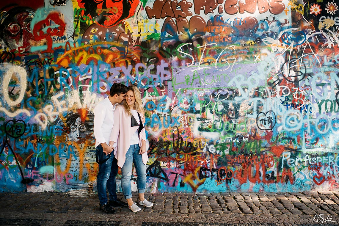 prewedding photography of symphatetic couple by the Lennon wall