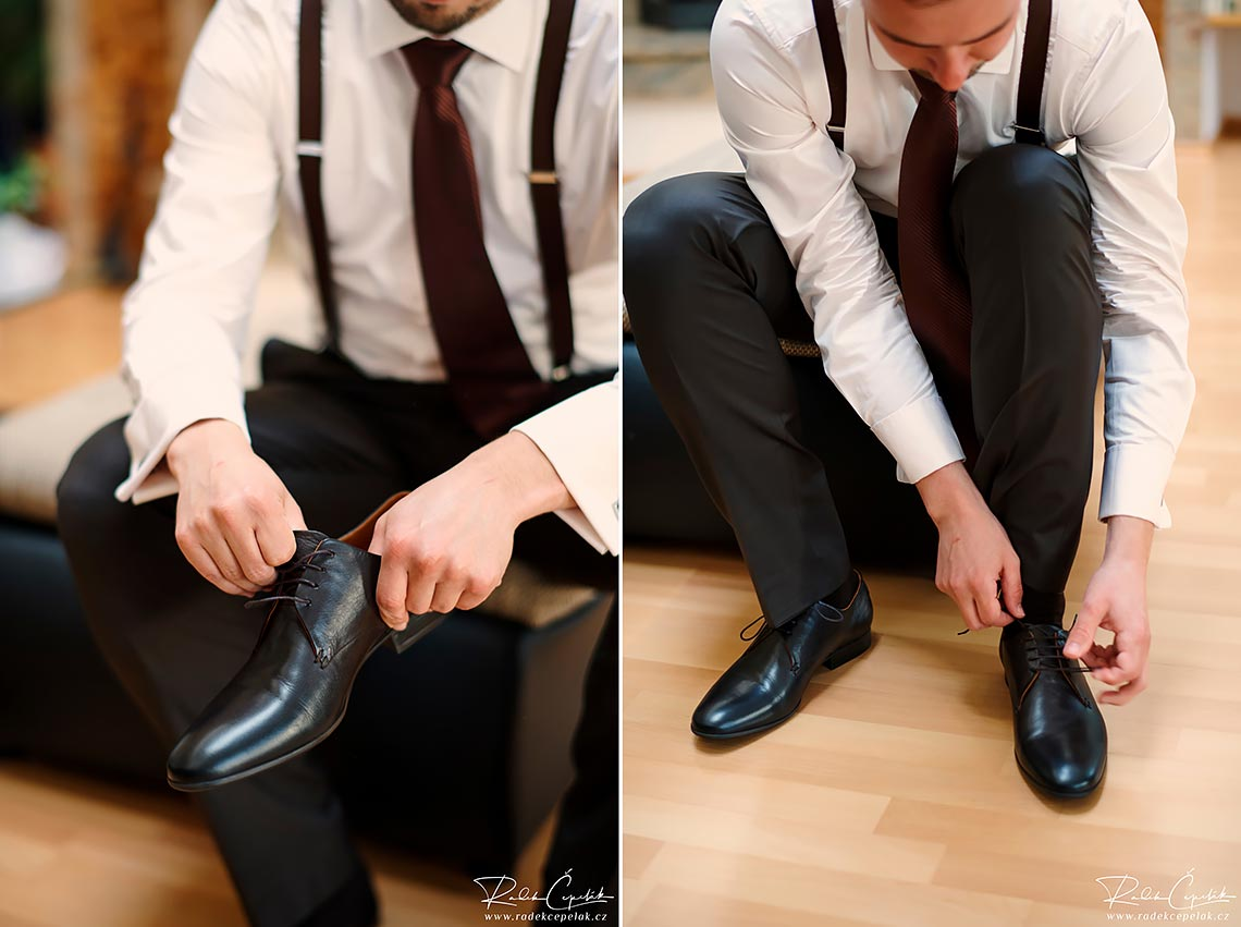 groom puts on shoes at wedding