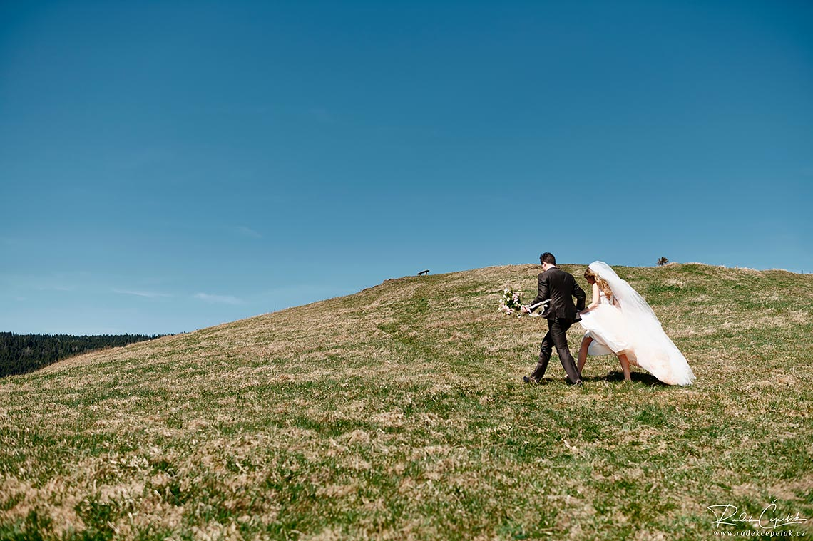 bride and groom walking in the nature