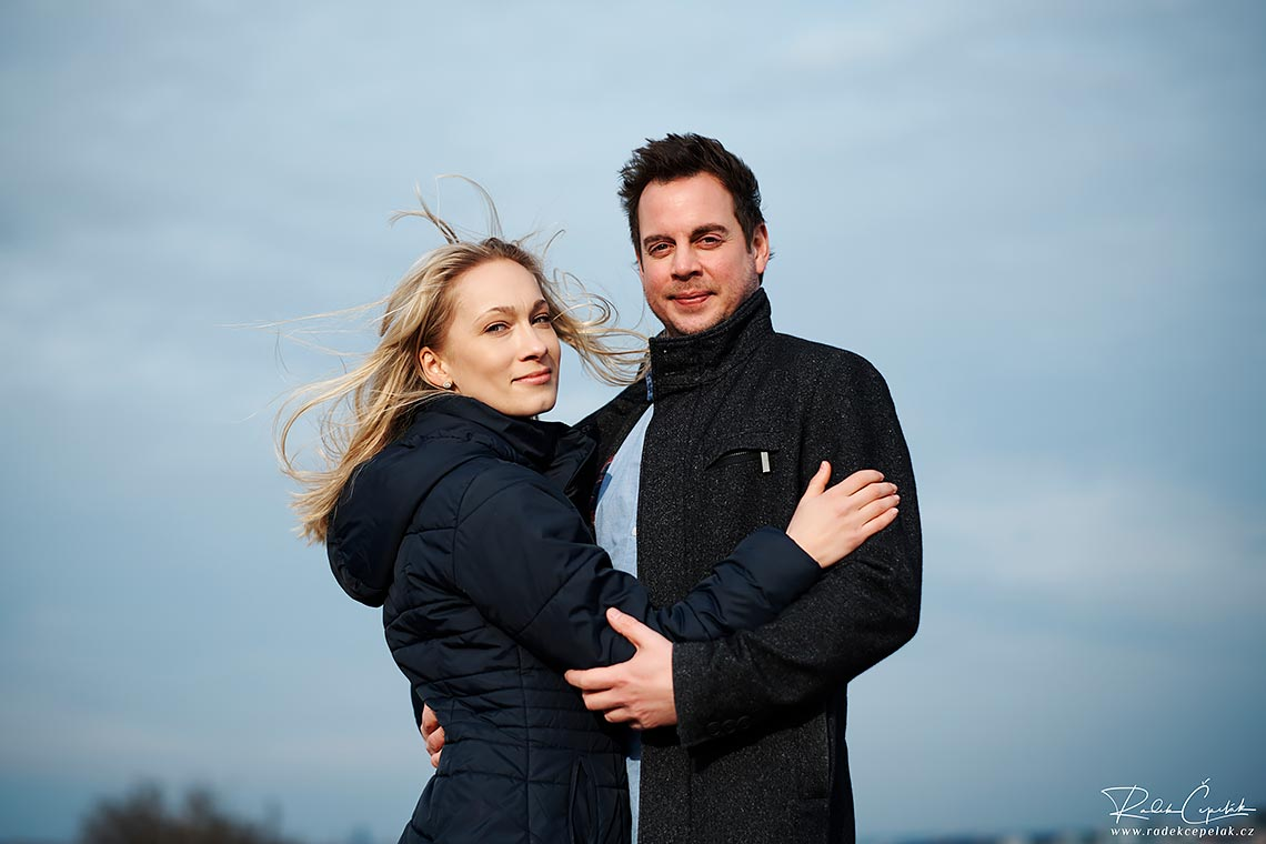 wind in hair during engagement session