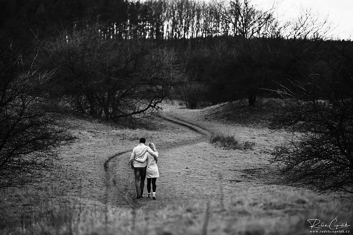 couple in love walking on the path in the nature