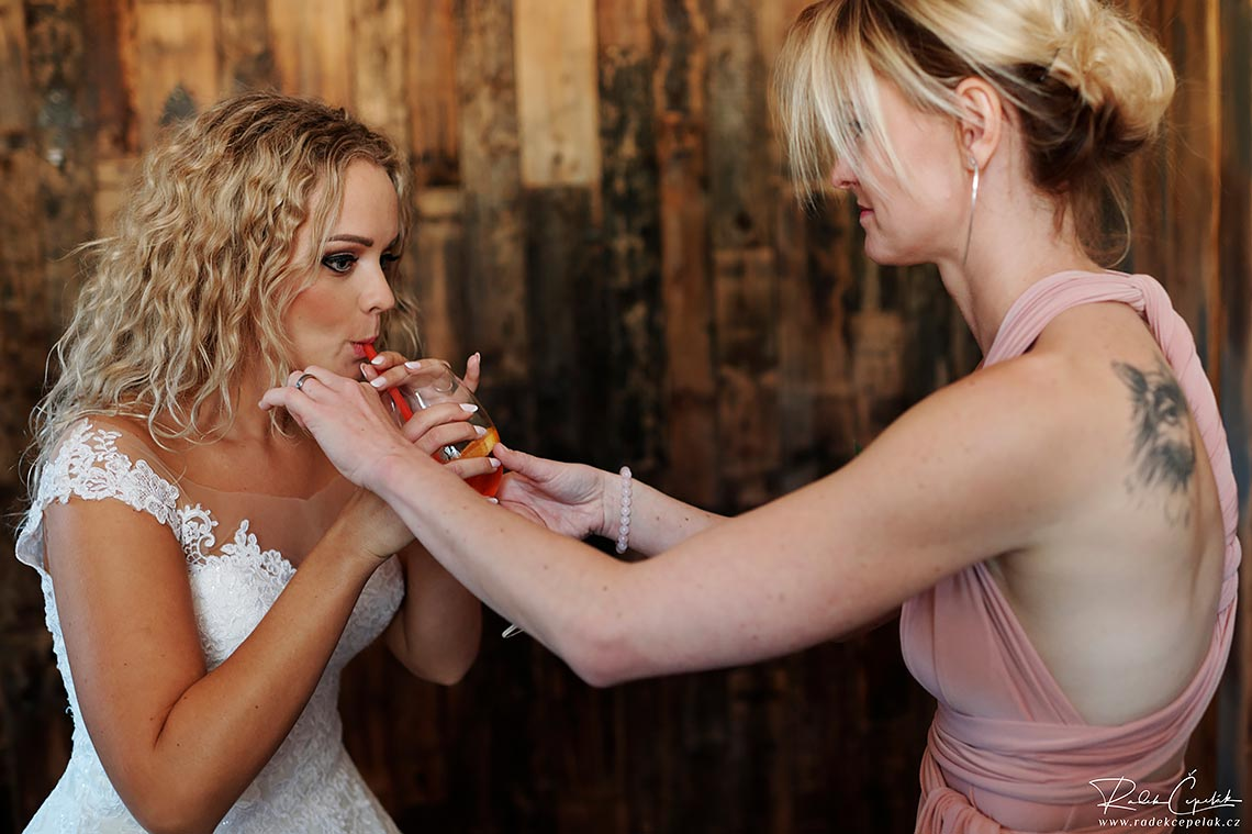 bride drinking alcohol before wedding ceremony
