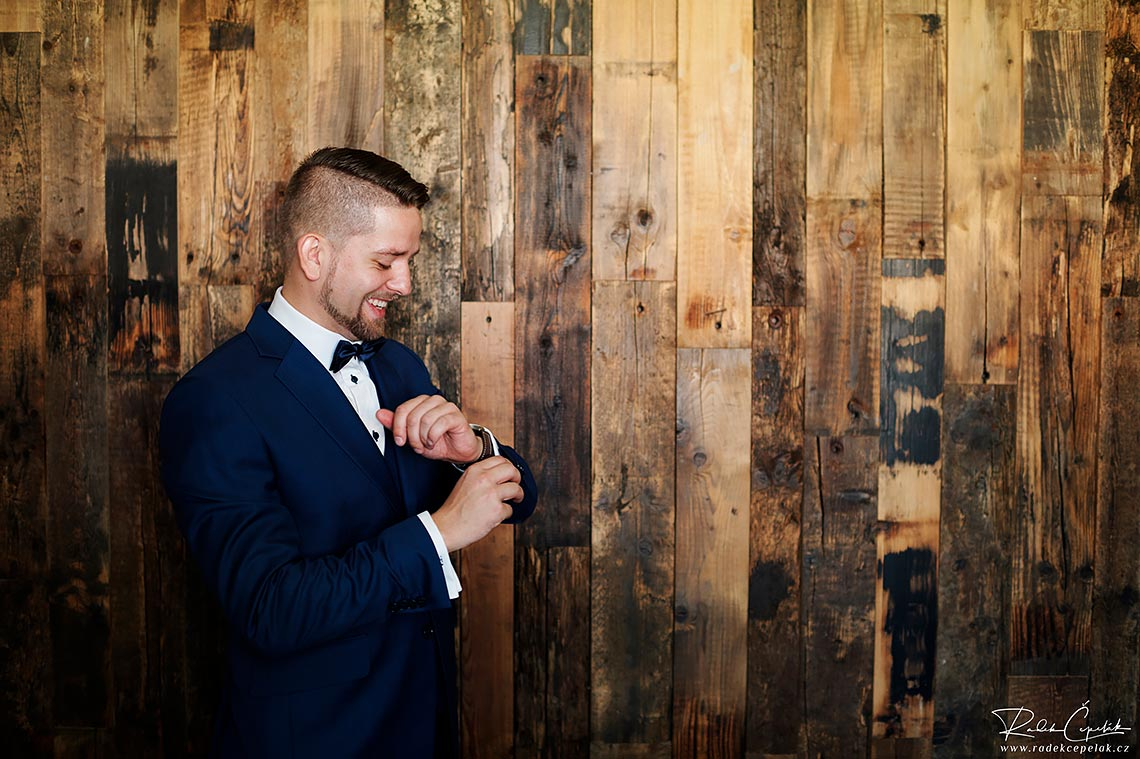 groom wedding photography of details of bow tie and initials on shirt