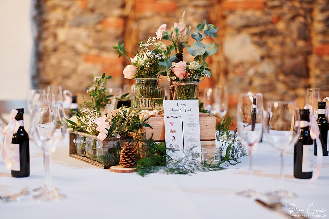 wedding floral decoration of tables in barn