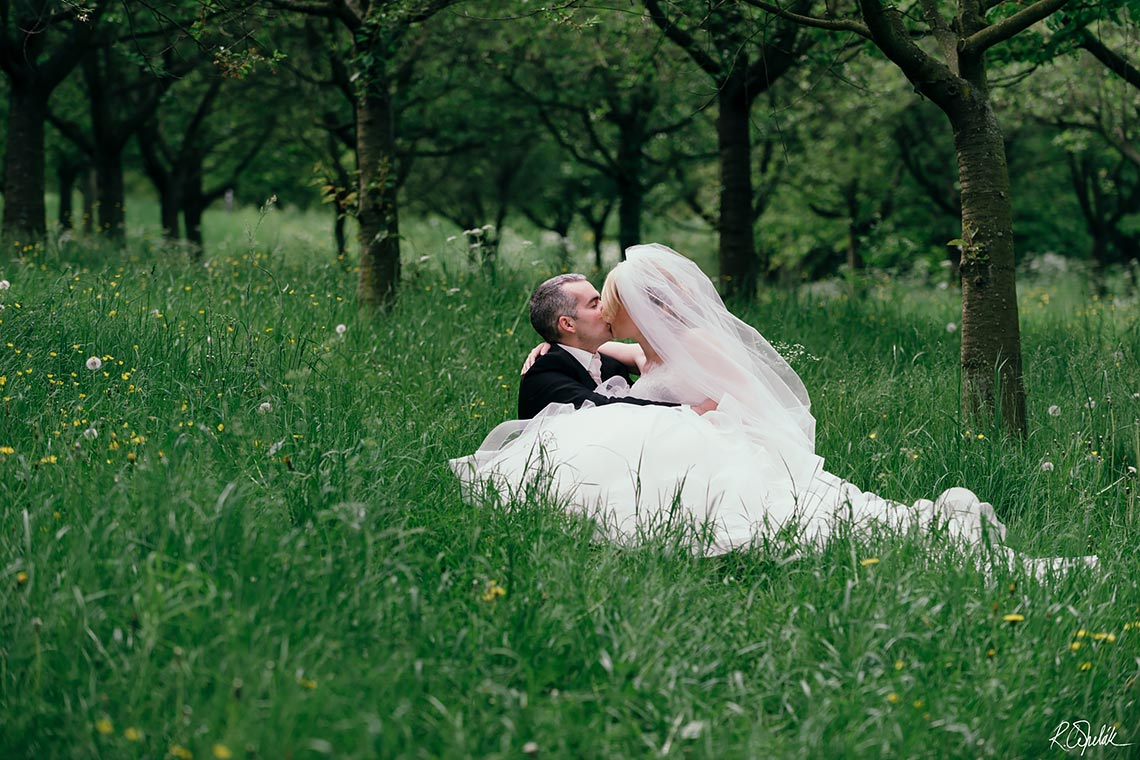 wedding photography of bride and groom in the grass