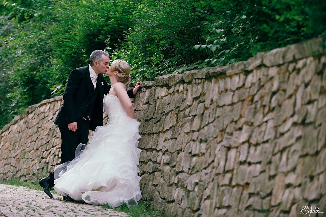 newlyweds couple photography by the old stone wall