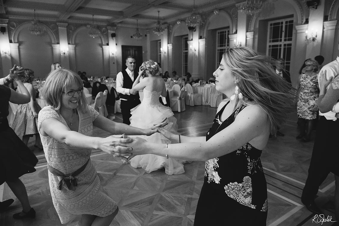 dancing guests at wedding party in Zofin palace in Prague