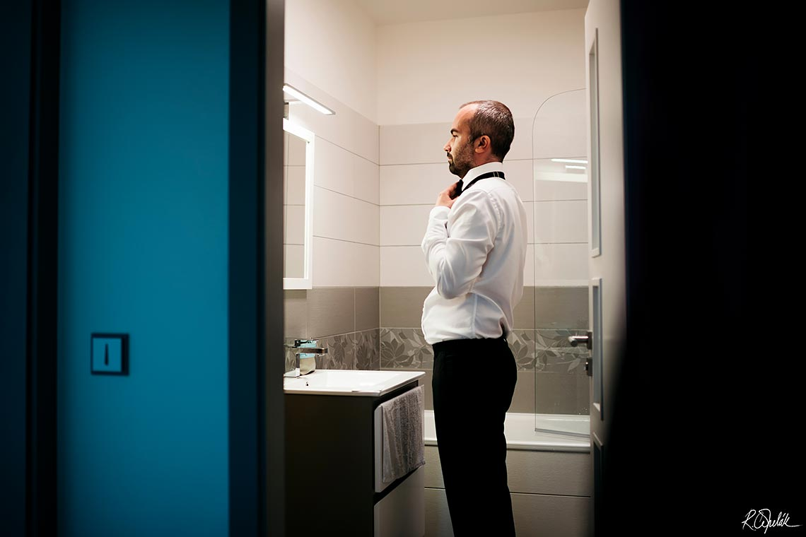 groom getting ready in the bathroom