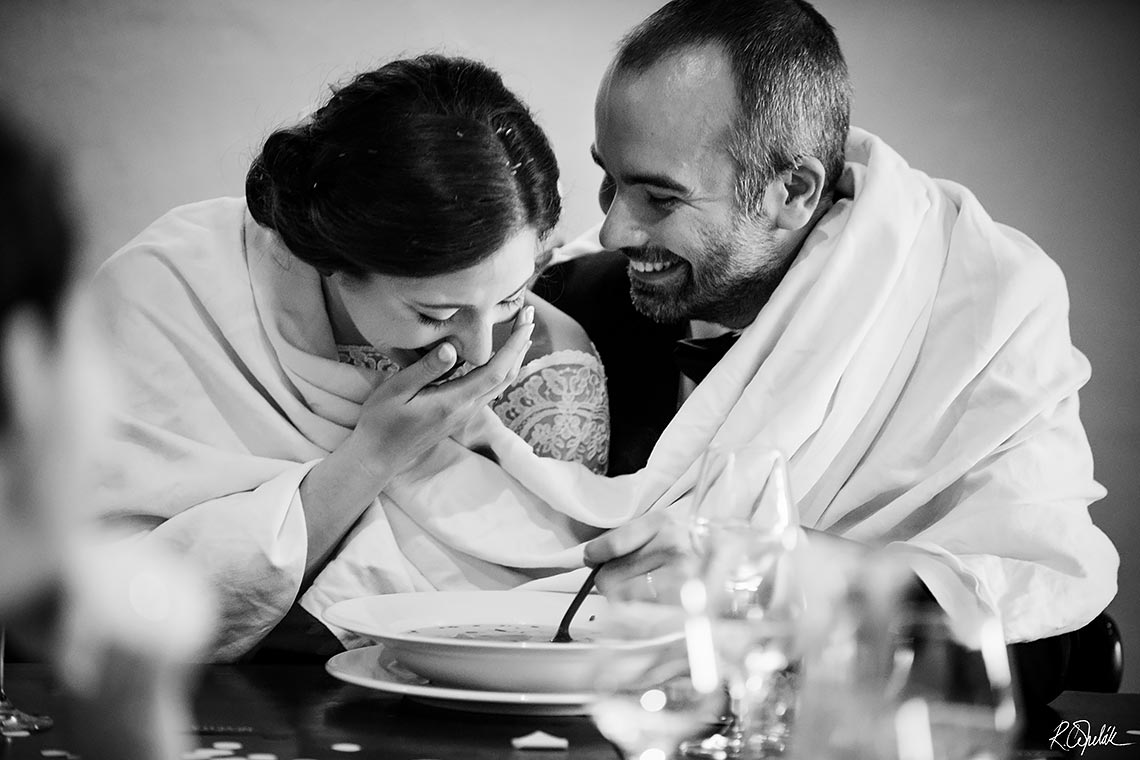 black and white photo of bride and groom eating the soup
