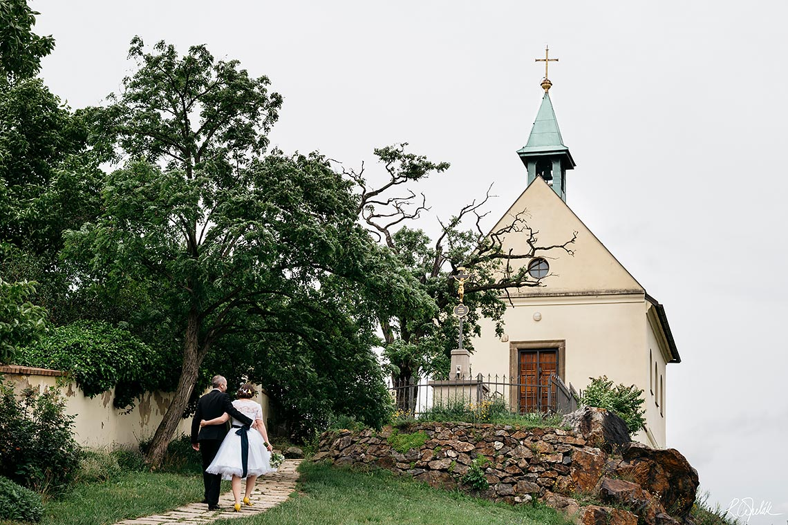wedding photo with small church