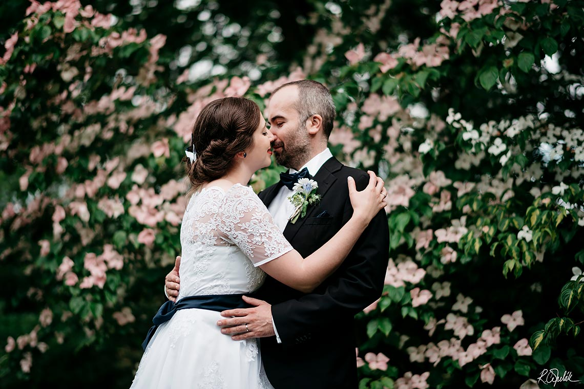 wedding photography in garden with blooming flowers