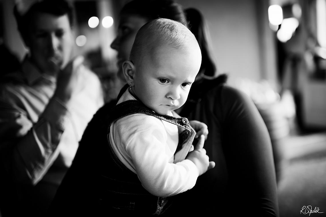 snapshot of baby at wedding reception