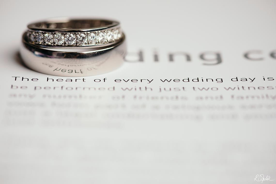 wedding rings on book detail macro photography
