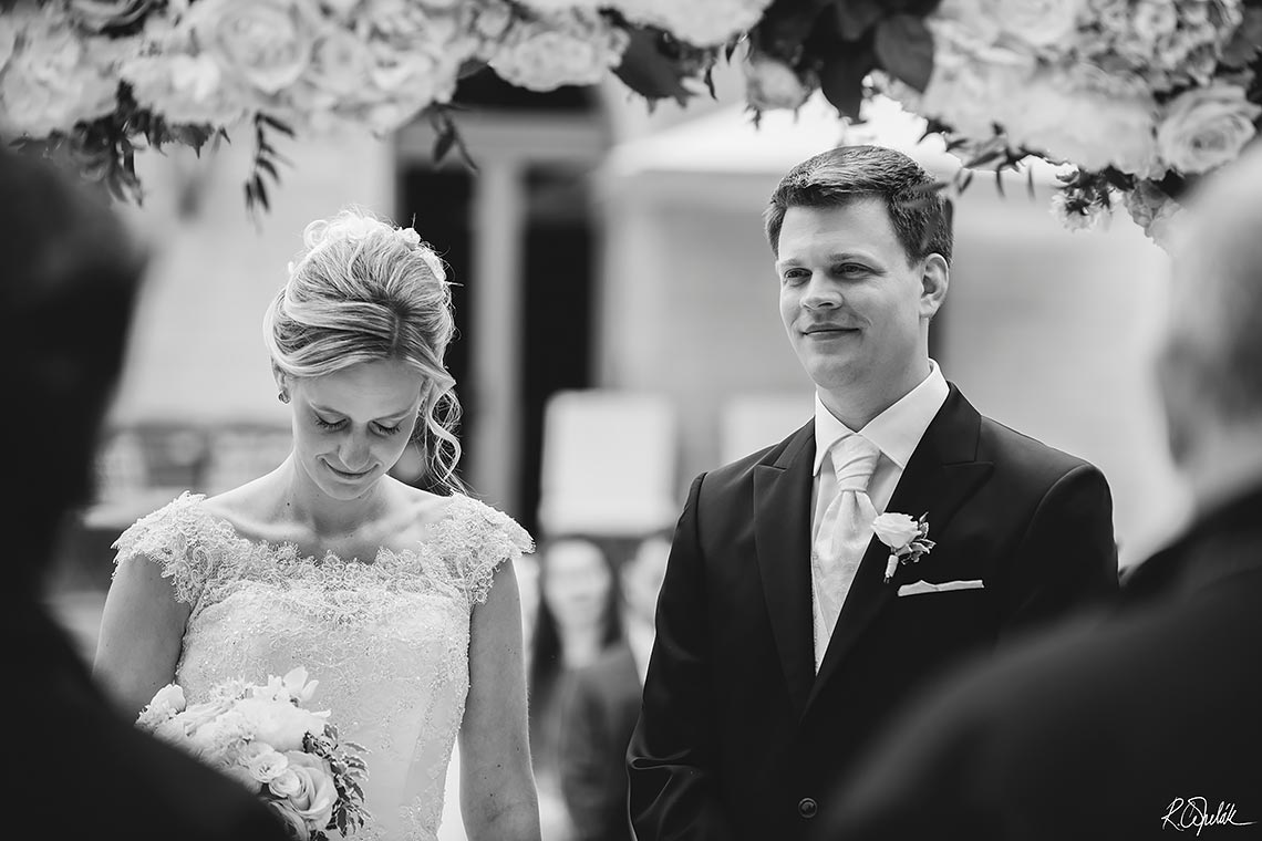 lovely bride with groom during ceremony black and white wedding photography