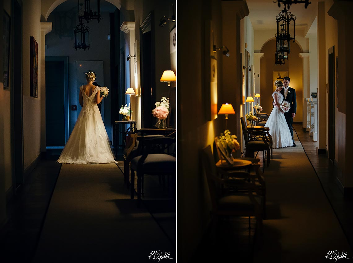 wedding potography of newlyweds at corridor of hotel Chateau Mcely in Czech republic