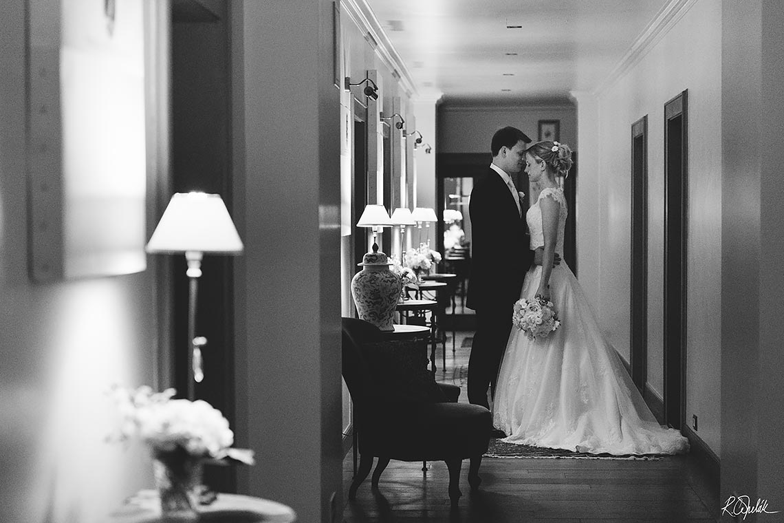 wedding potography of bride with groom at corridor of hotel Chateau Mcely in Czech republic