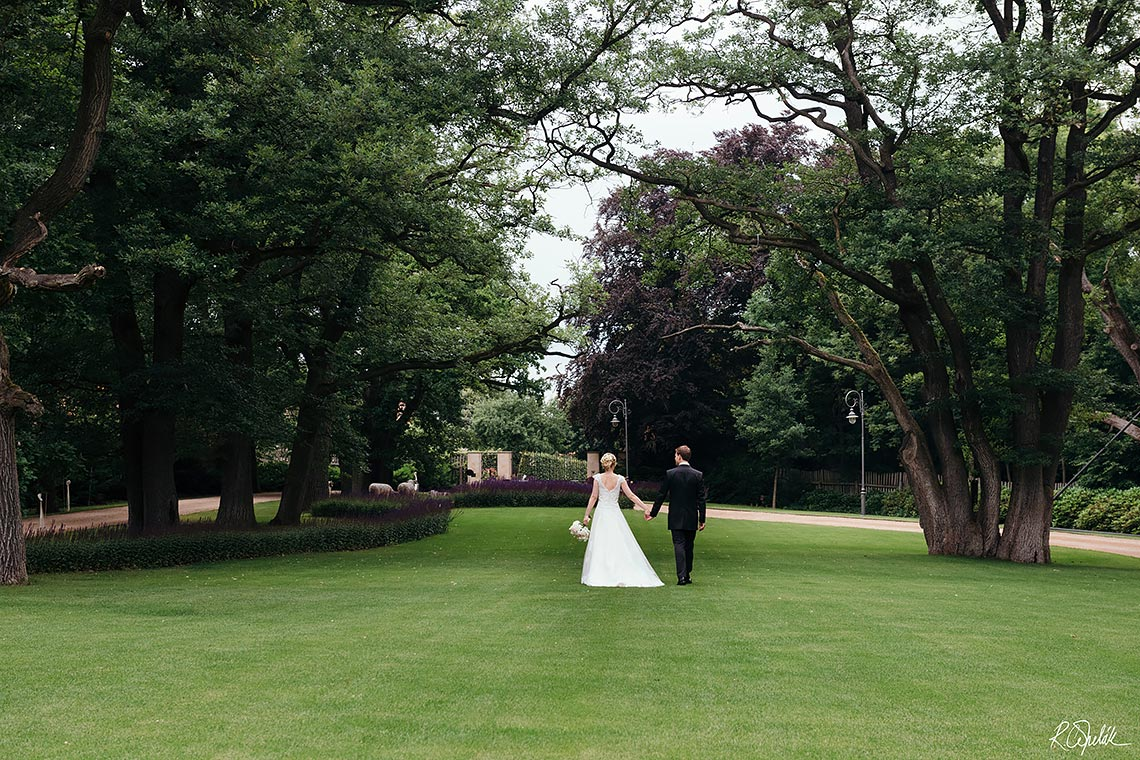 bride with groom at Chateau Mcely garden