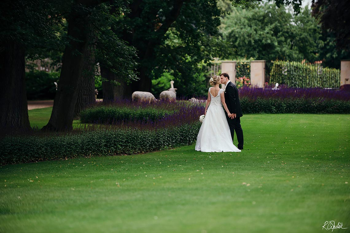 bride and groom in the garden of Chateau Mcely