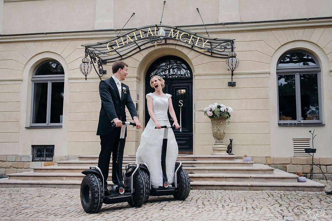 funny wedding photography of bride and groom on Segway