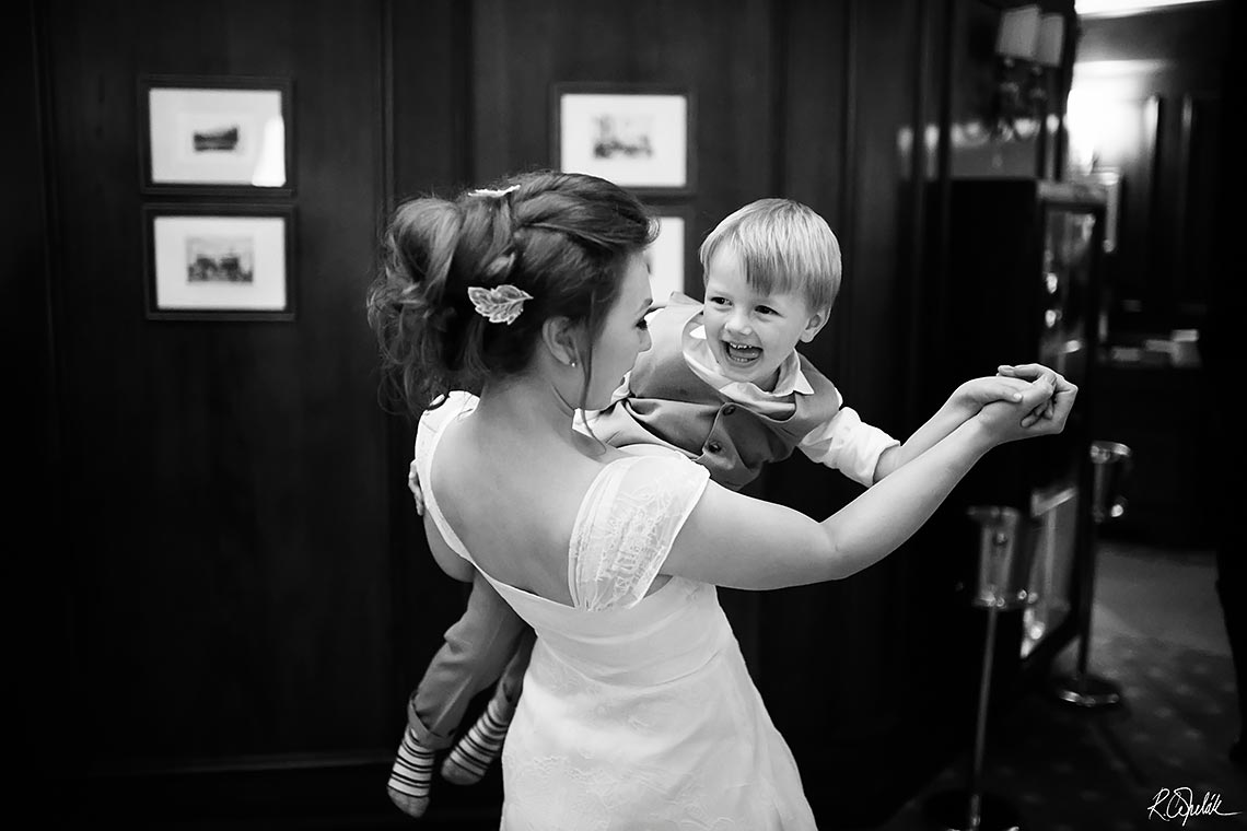 bride dancing with child at wedding