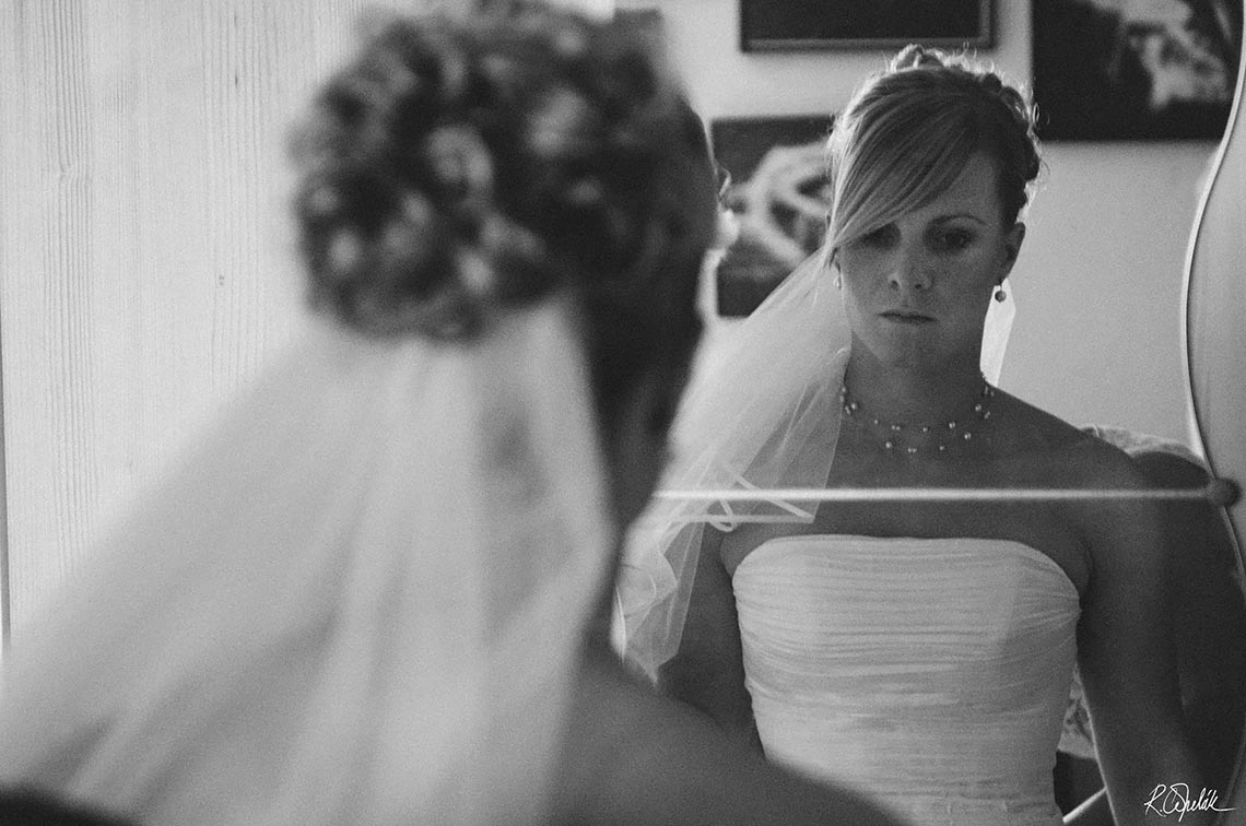 black and white photo of bride in the mirror