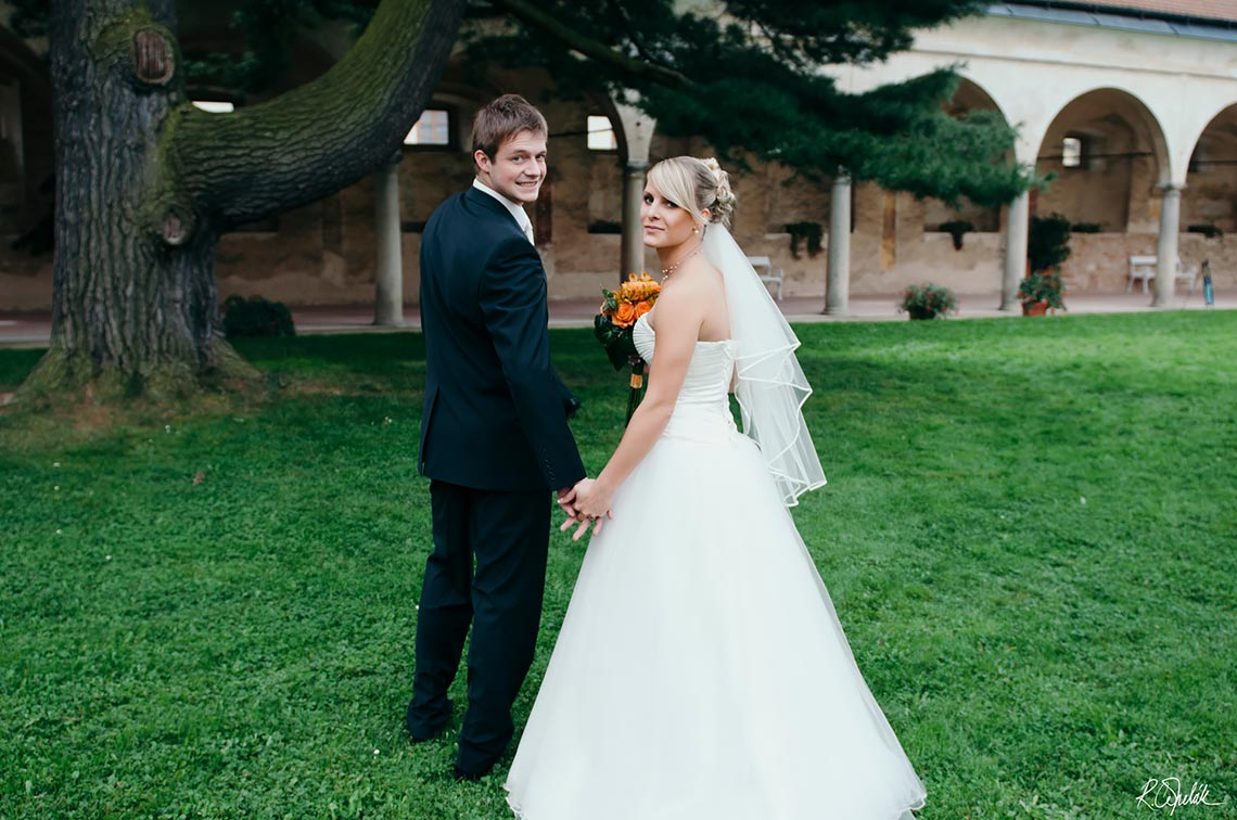 bride and groom at castle garden in city Telc