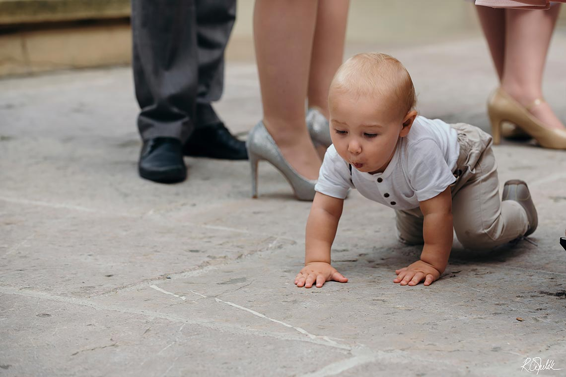 funny snapshot of baby at wedding