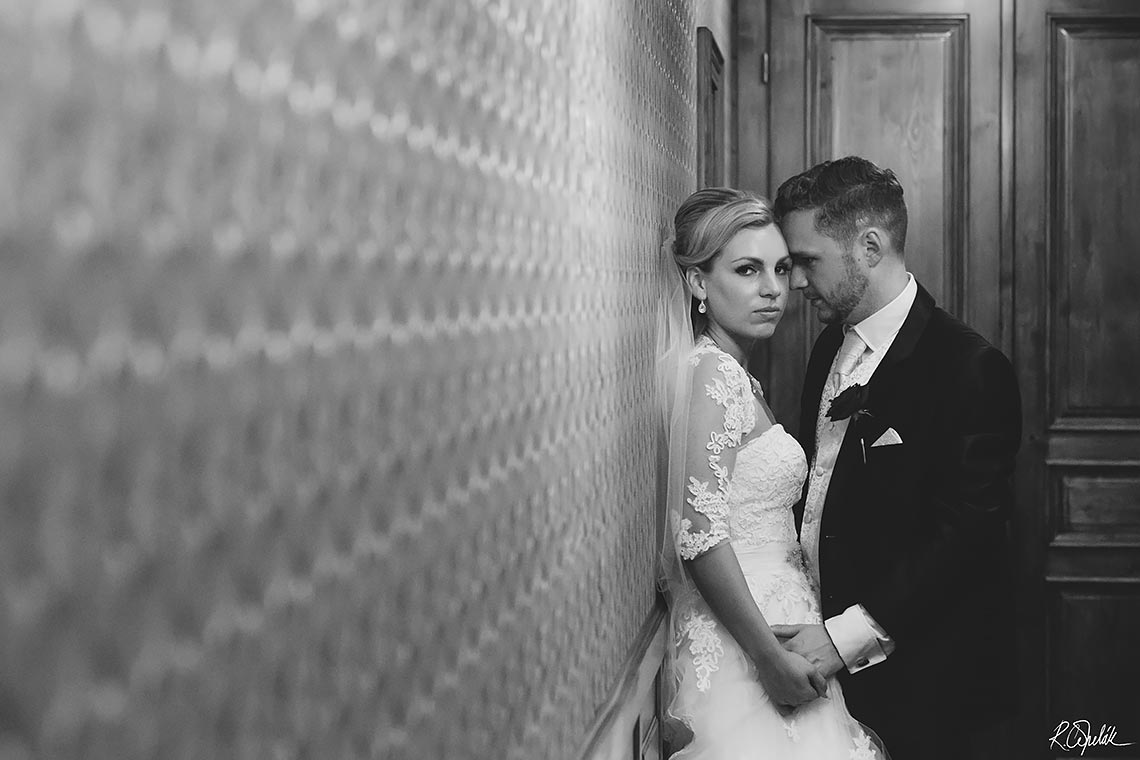 wedding photo of newlyweds in corridor at Chateu St. Havel in Prague