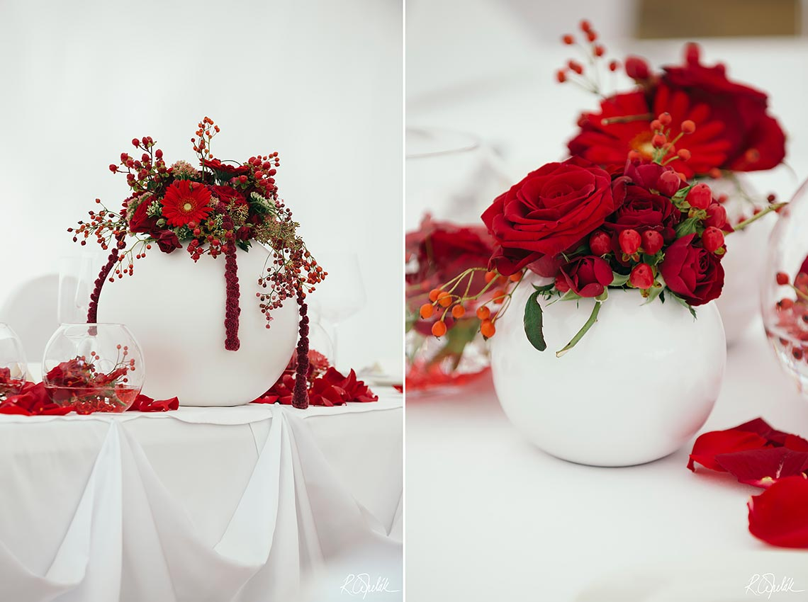wedding reception with red flowers at Chateau St. Havel in Prague