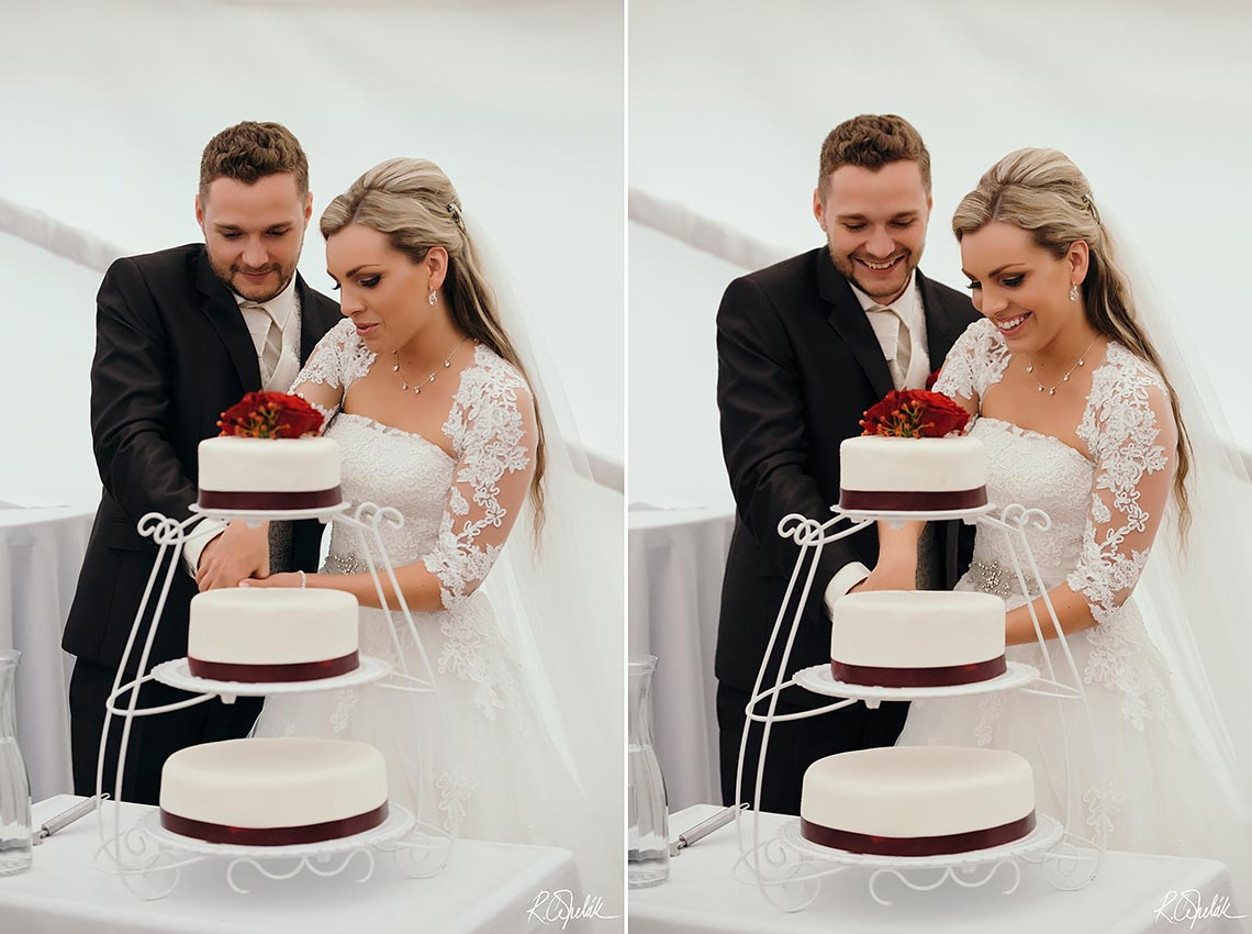 bride and groom cutting three-storey red-white wedding cake