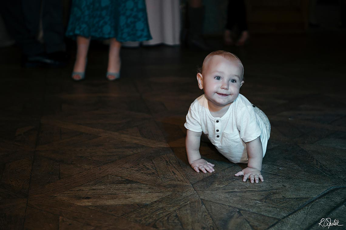 funny snapshot of baby on the dance floor at wedding